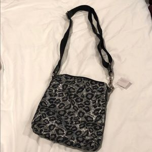Cheetah Print Coach crossbody bag. Black & silver